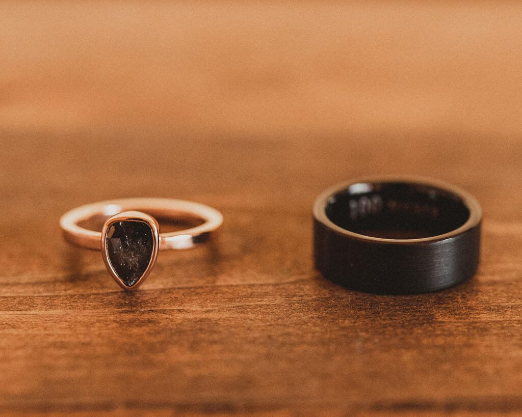 Black teardrop engagement ring and black men's wedding band