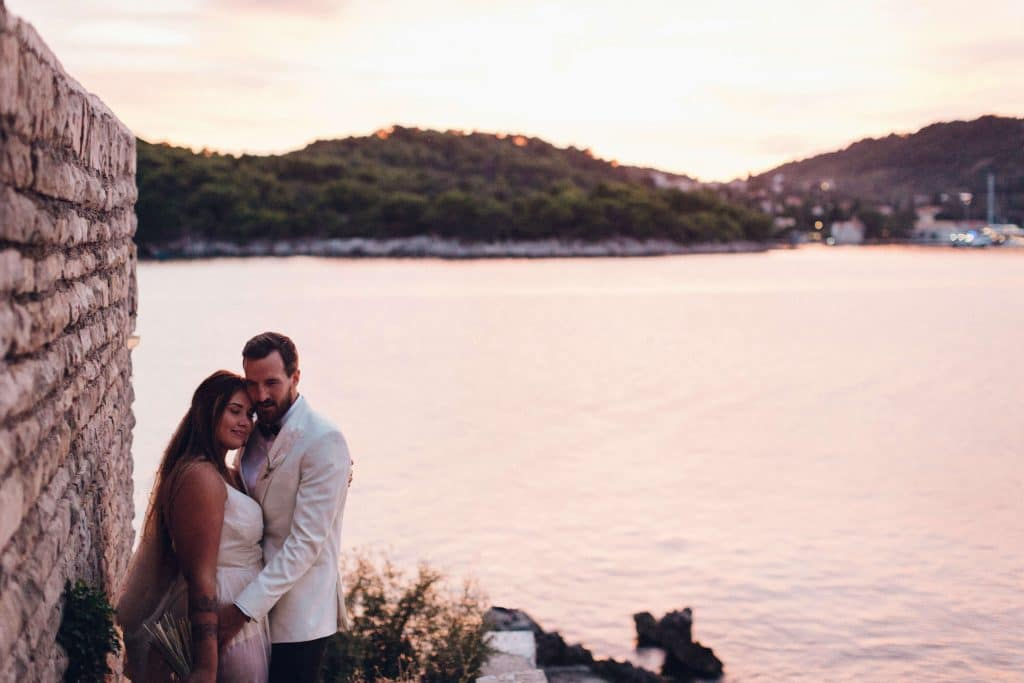 bride and groom at sunset in Croatia. Intimate wedding ceremony on the rock cliffs near Dubrovnik with only 15 guests. Destination wedding planner 'Cause We Can Events