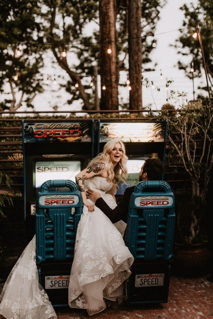 Bride and groom playing arcade games during wedding at Smoky Hollow Studios