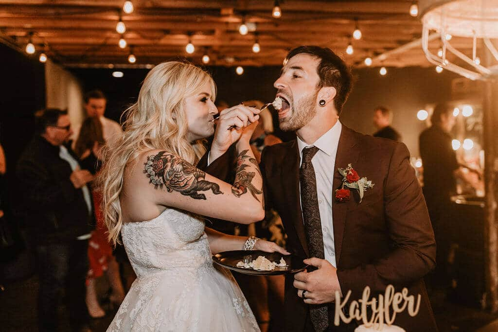 Cake cutting for tattoo bride and groom at Smoky Hollow Studios