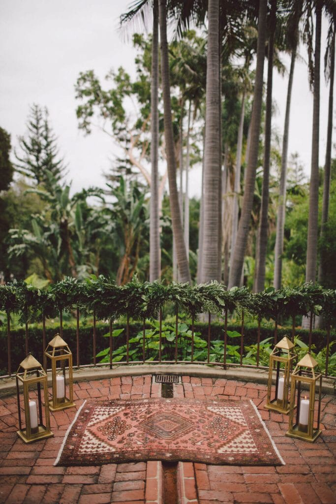 Romantic wedding ceremony decor with boho rug detail
