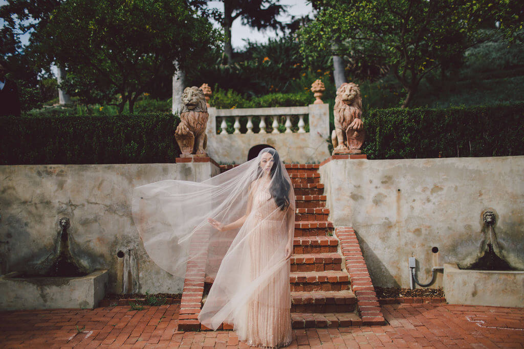 Bridal shoot with a full length veil at the Virginia Robinson wedding in Beverly Hills