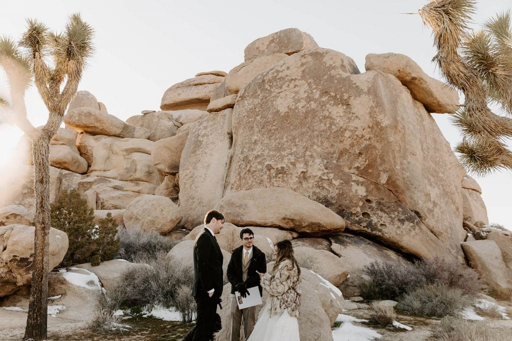 Ceremony at Cap Rock in Joshua Tree National Park. Winter ceremony in the desert with snow.