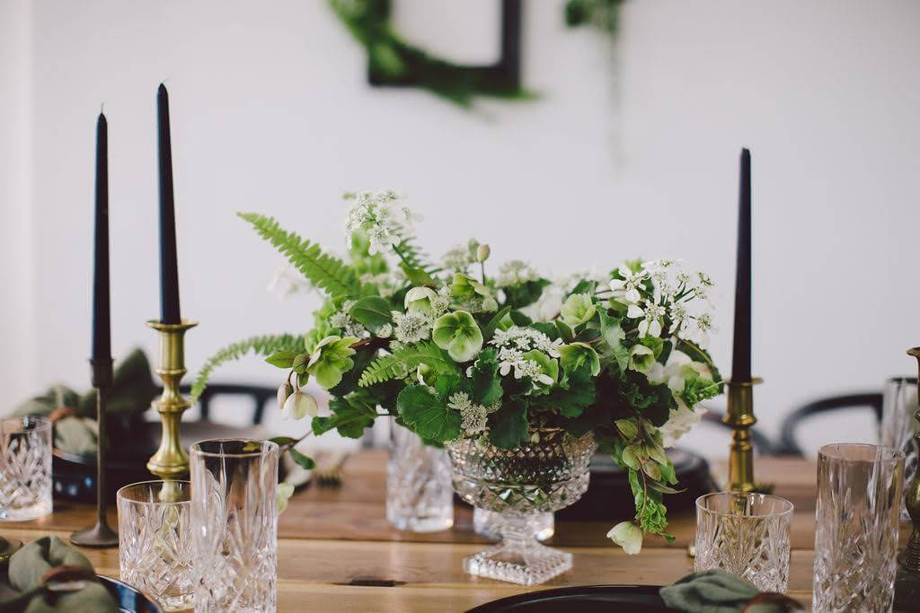 Simple white and green flowers with black candlesticks for eco friendly wedding
