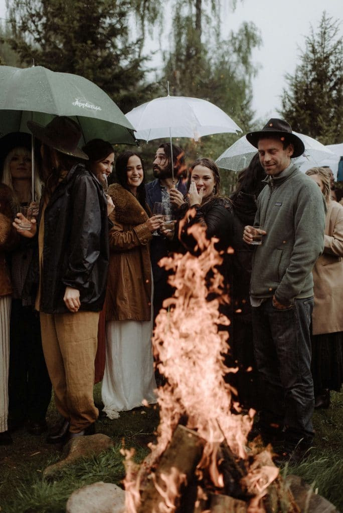 Bride and groom light fire at wedding in Scotland in the rain