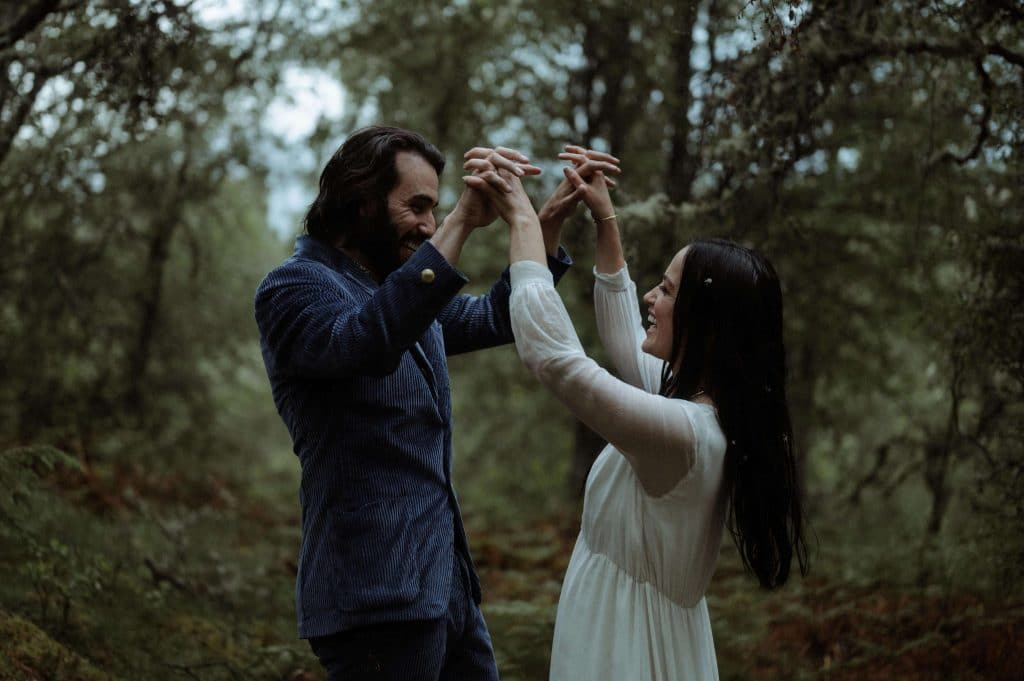 Bride and groom first dance in forest at Inshriach House in Scotland