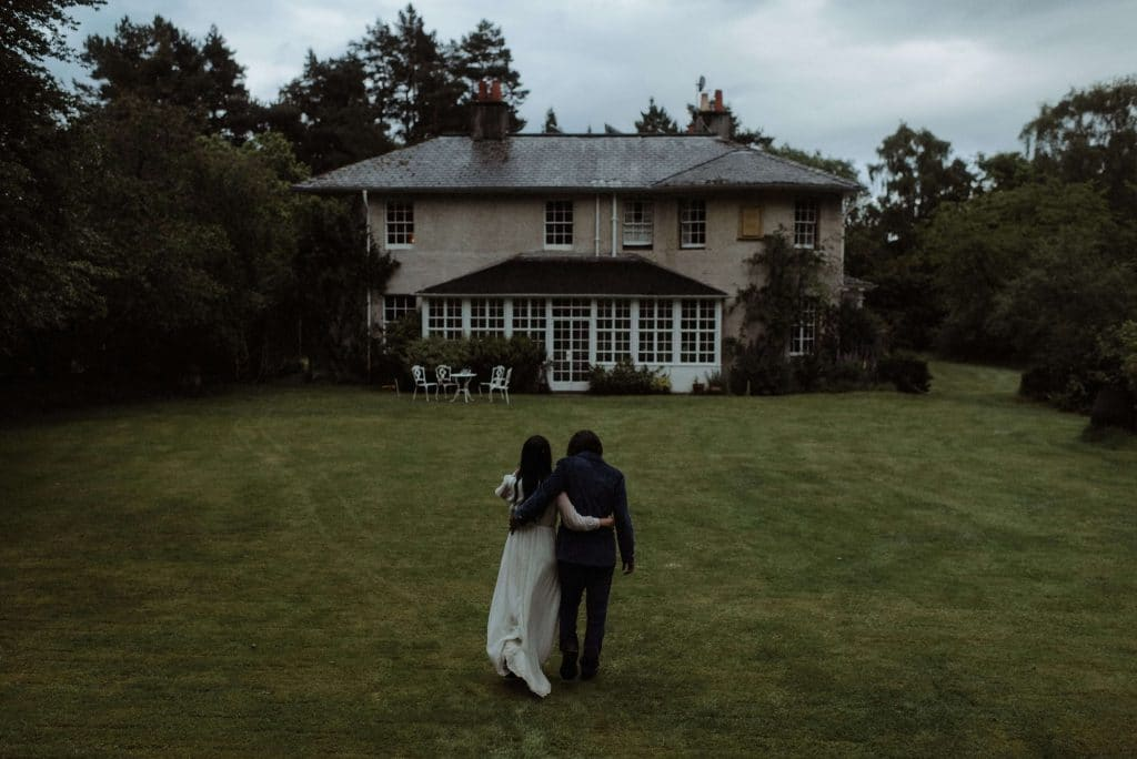 Wedding at Inshriach House in Inverness Scotland. Bride and groom got married by the river and had an intimate reception for 35 guests inside the manor.