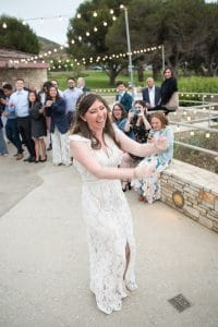 A bride surprises guests with a choreographed dance sequence with friends