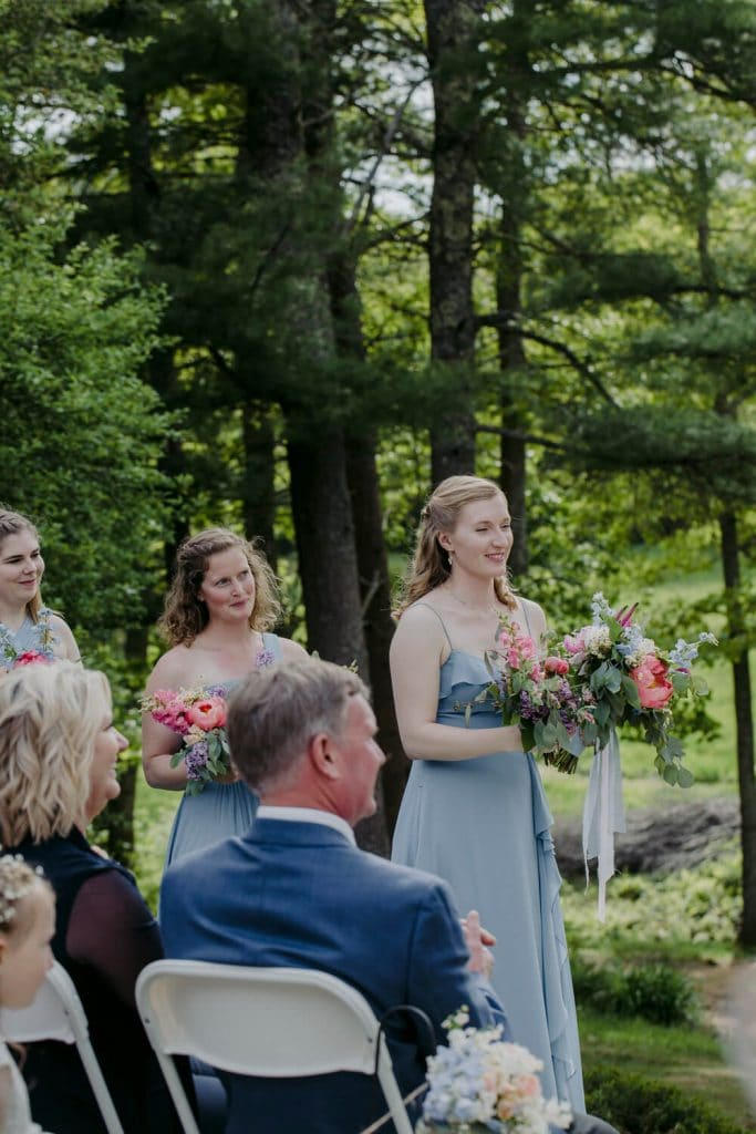 Bridesmaids in a soft blue dress during a ceremony in Maine at the Squire Tarbox Inn