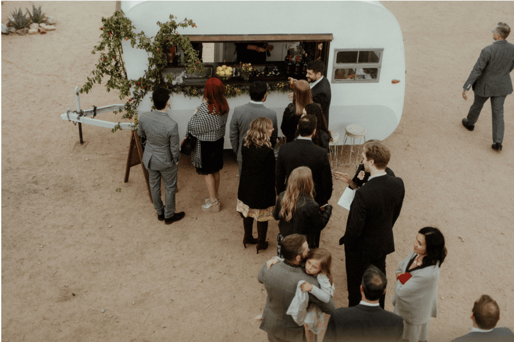 The Old Fashioned Mobile Bar serves up cocktails at a fun wedding reception at Rimrock Ranch desert venue.