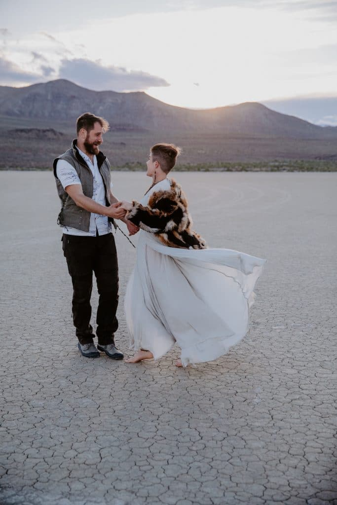 A bride and groom pose in the Black Rock Desert for their Burning Man wedding.