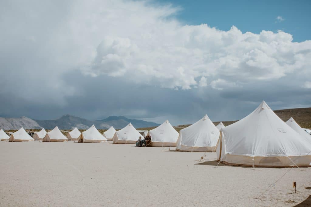 Glamping tents for a desert wedding by Cause We Can Events and Stout Tents for a Burning Man vibe.