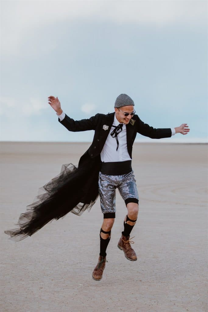 A Burning Man wedding guest dressed up creatively for the ceremony in the desert.