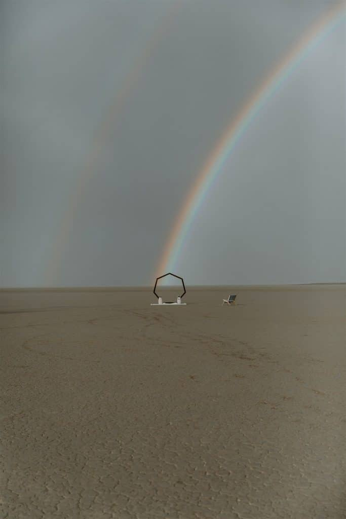 A double rainbow formed over a desert wedding ceremony.