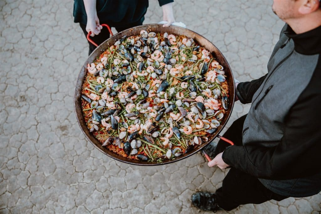 Paella served in the desert by Big Blue Q, a Tahoe wedding caterer.