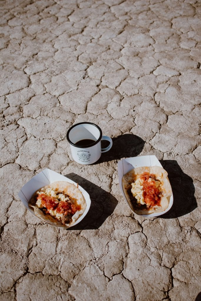Breakfast tacos served up to guests for a remote desert wedding inspired by a music festival.