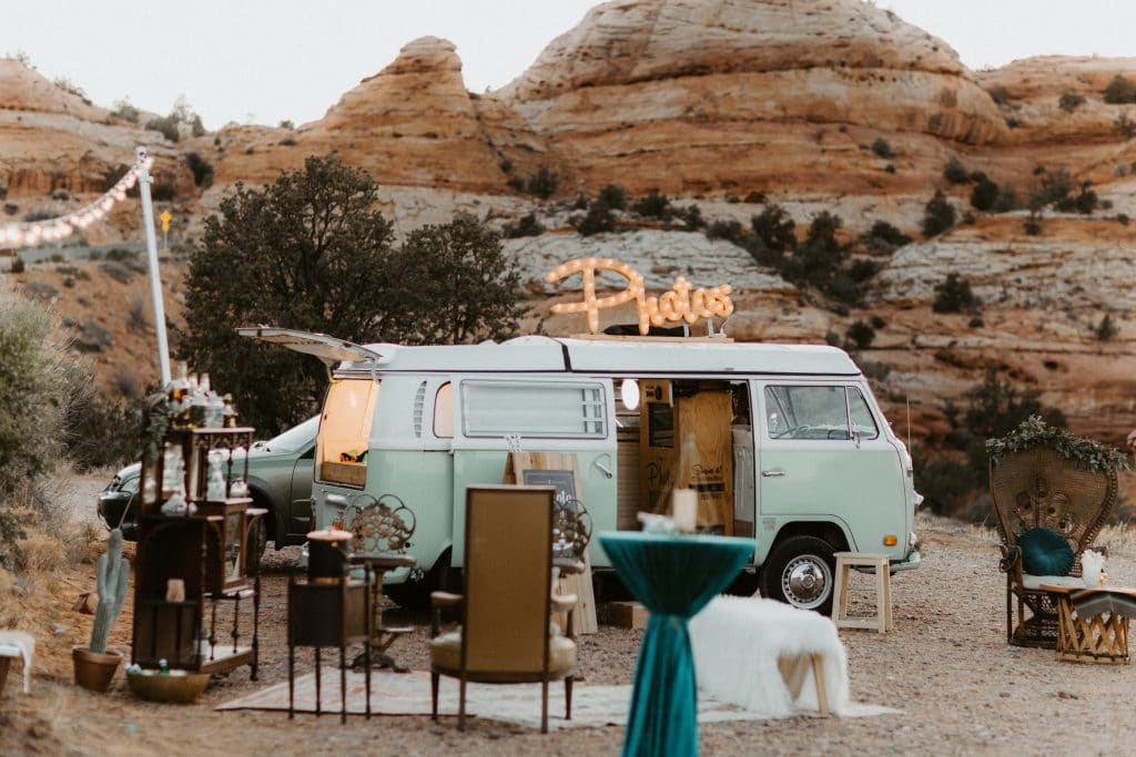 teal photobooth bus at a wedding in the desert in Utah