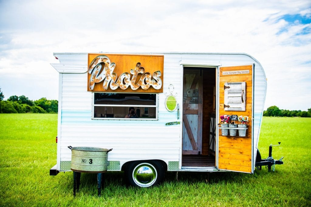 Cute vintage trailer photobooth bus at wedding