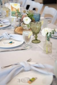 A blue, green and grey color palette for a wedding reception table in Palos Verdes.