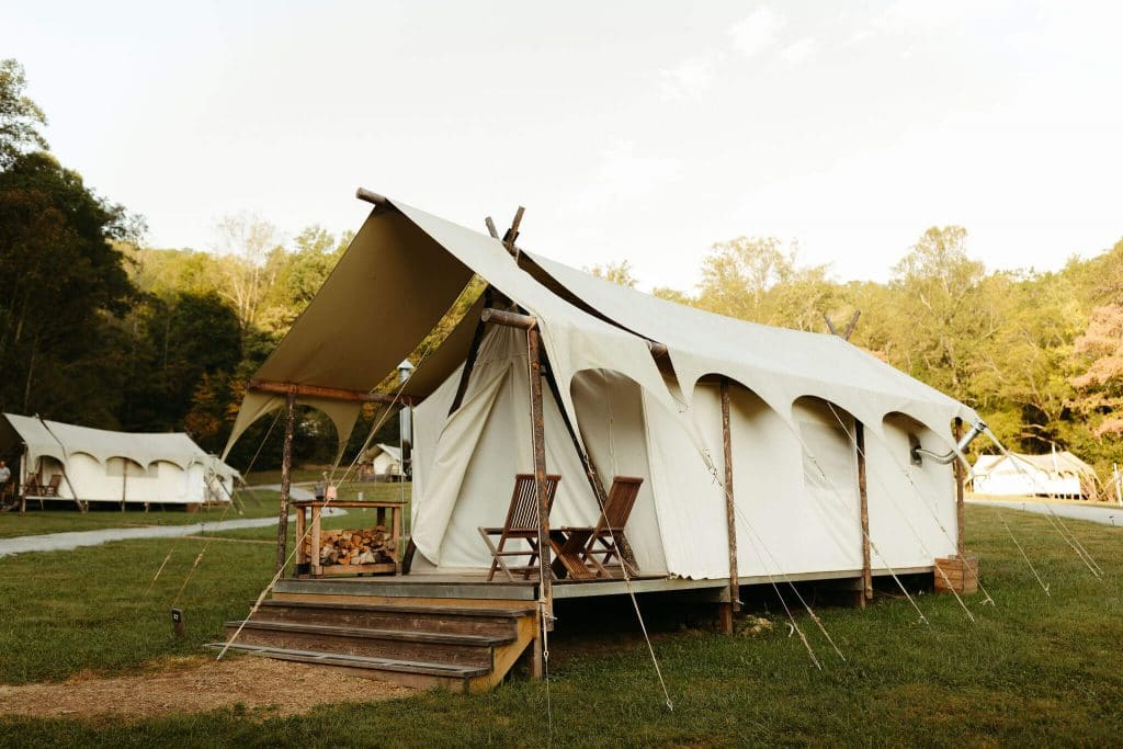 Tents and teepees at Under Canvas Smoky Mountains. Festival-style wedding where couples and guests can sleep onsite in glamping tents for the weekend