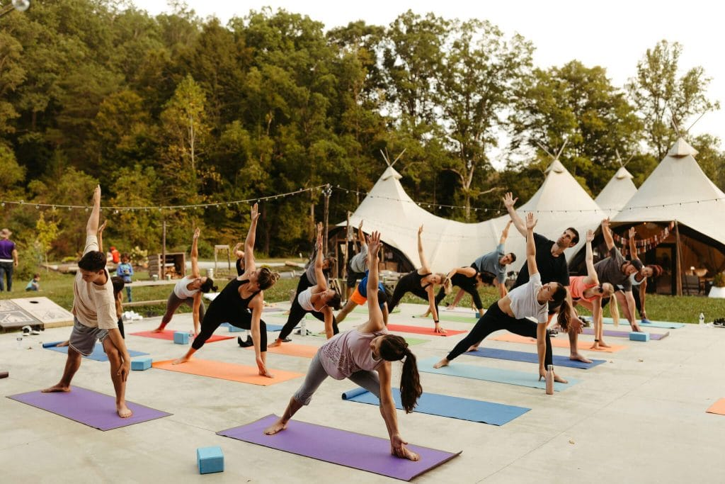Wedding yoga session at Under Canvas Smoky Mountains