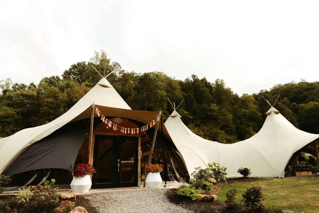 Wedding venue entrance with tassels. Under Canvas Smoky Mountains Wedding.
