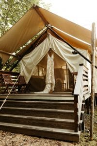 Tent at Under Canvas Smoky Mountains with boho wedding dress hanging