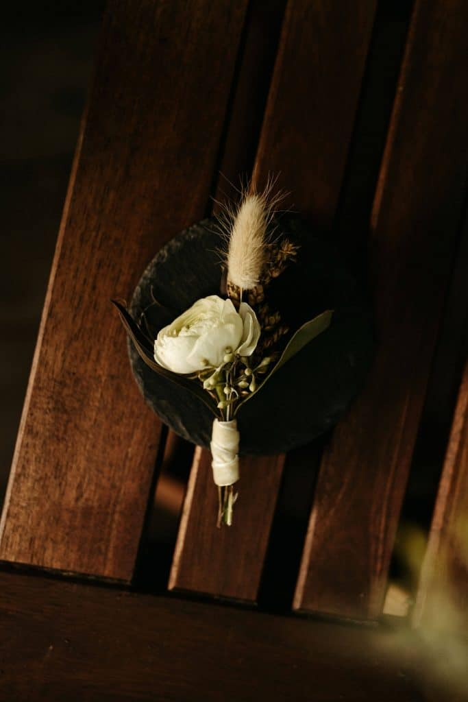 Boho boutonniere with white flower and mini pampass grass