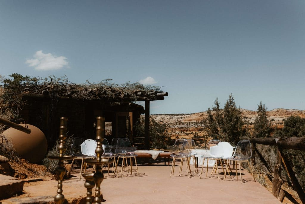 Intimate wedding at Kiva Koffeehouse in Escalante, Utah. Ceremony set up on back patio of coffee shop overlooking the desert.