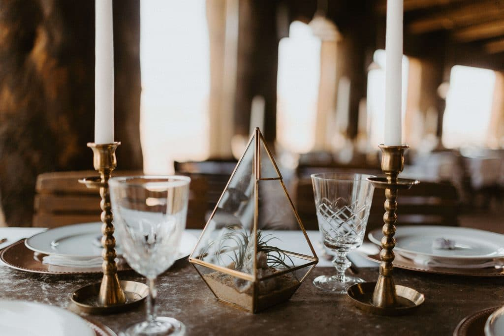 Glass geometric gold planters with little succulents, gold candlesticks and vintage crystal class for intimate wedding at Kiva Koffeehouse in Escalante, Utah