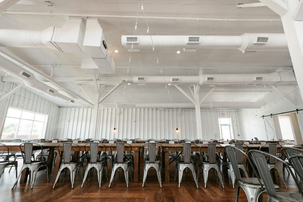 Metal chairs and wooden tables for reception at 14Tenn