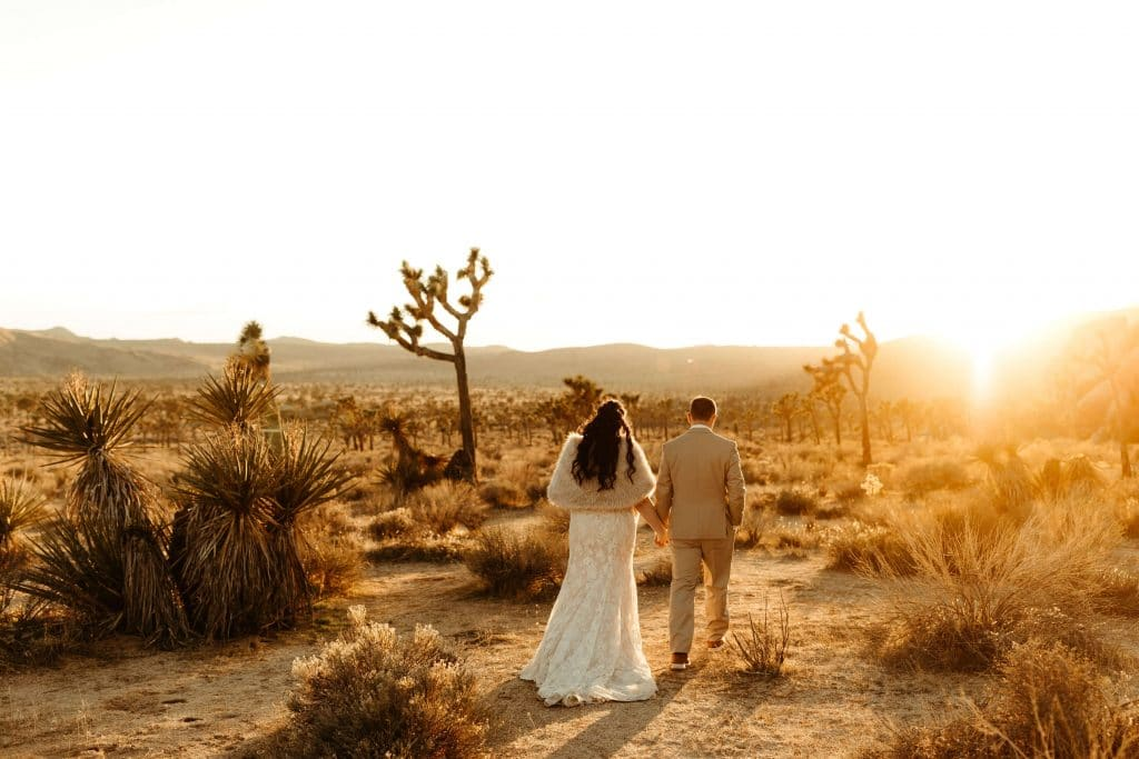 Bride and groom during sunset at Joshua Tree elopement
