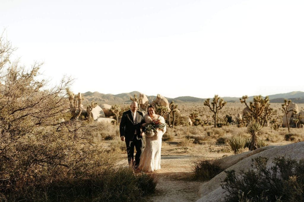 bride and father walk down aisle at Joshua Tree elopement