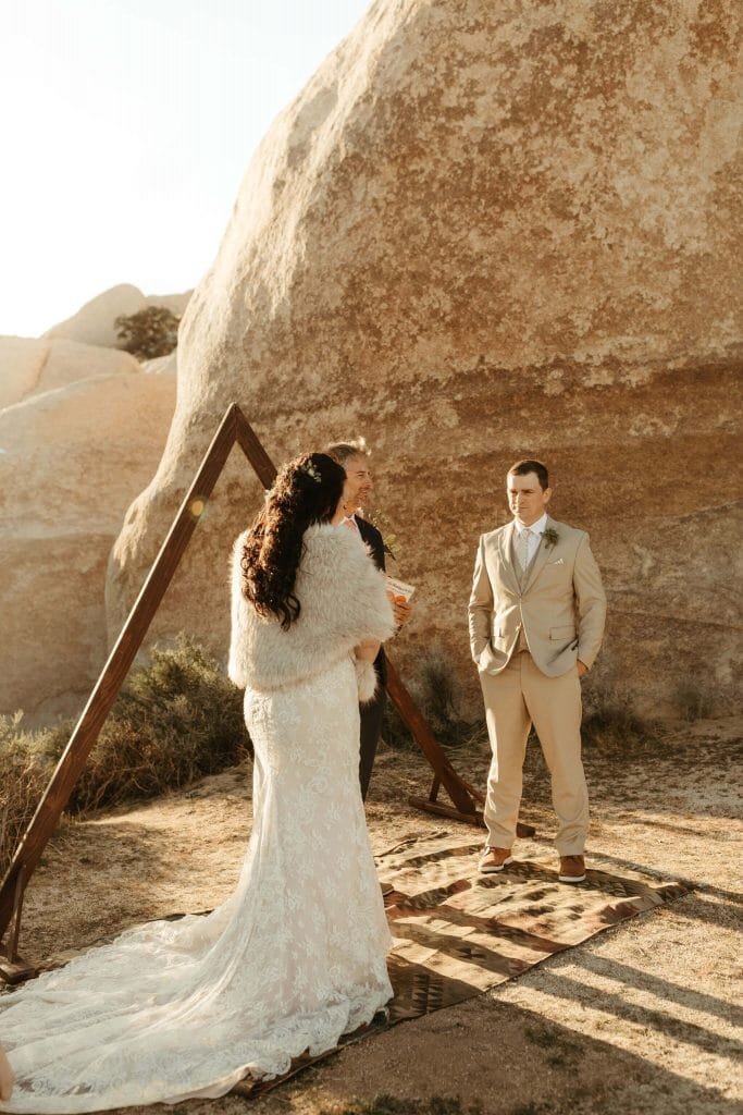 Intimate ceremony with triangle arch in Joshua Tree
