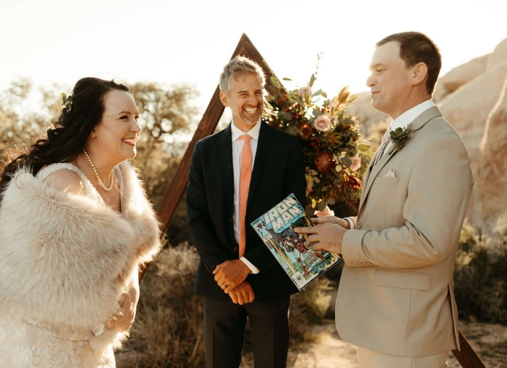 Comic book vow book for Joshua Tree elopement and triangle arch