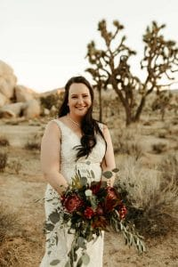 Bride with long brown wavy hair and big boho bouquet in Joshua Tree