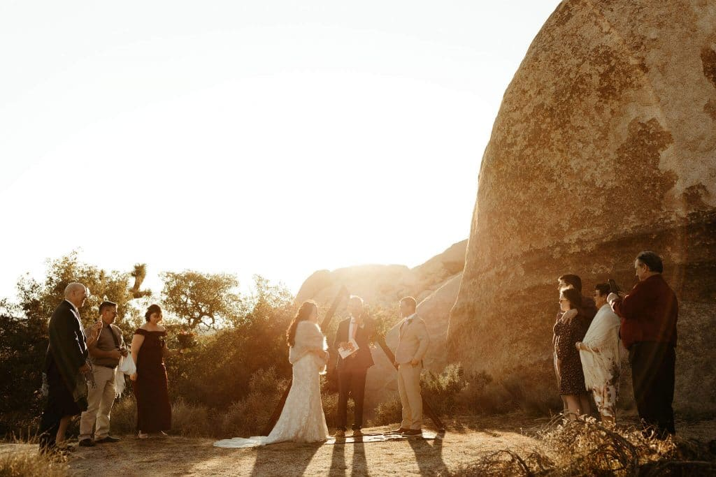 Sunset ceremony with triangle arch and boho rug at Joshua Tree National Park