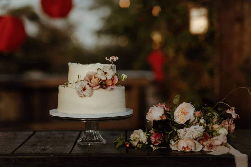 Simple minimalist wedding cake with delicate flowers