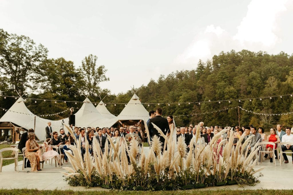 Boho wedding ceremony at Under Canvas Smoky Mountains