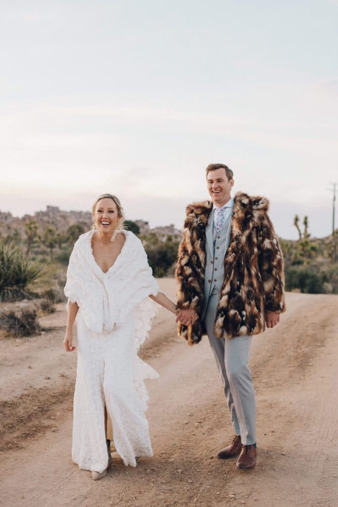 bride and groom with faux fur jacket