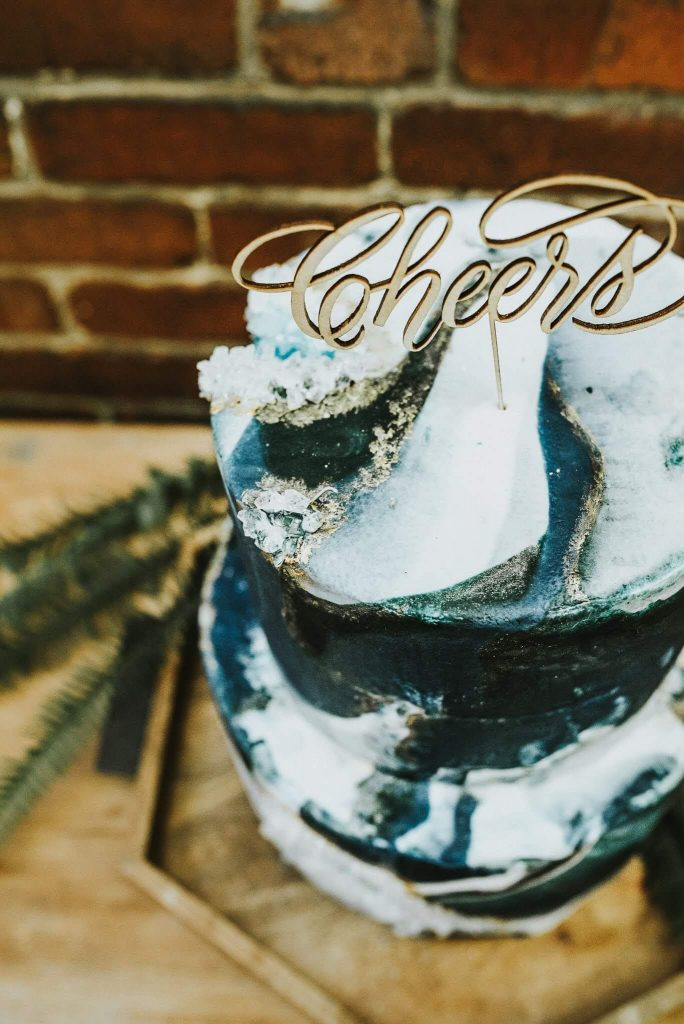 Cheers cake topper on geode cake