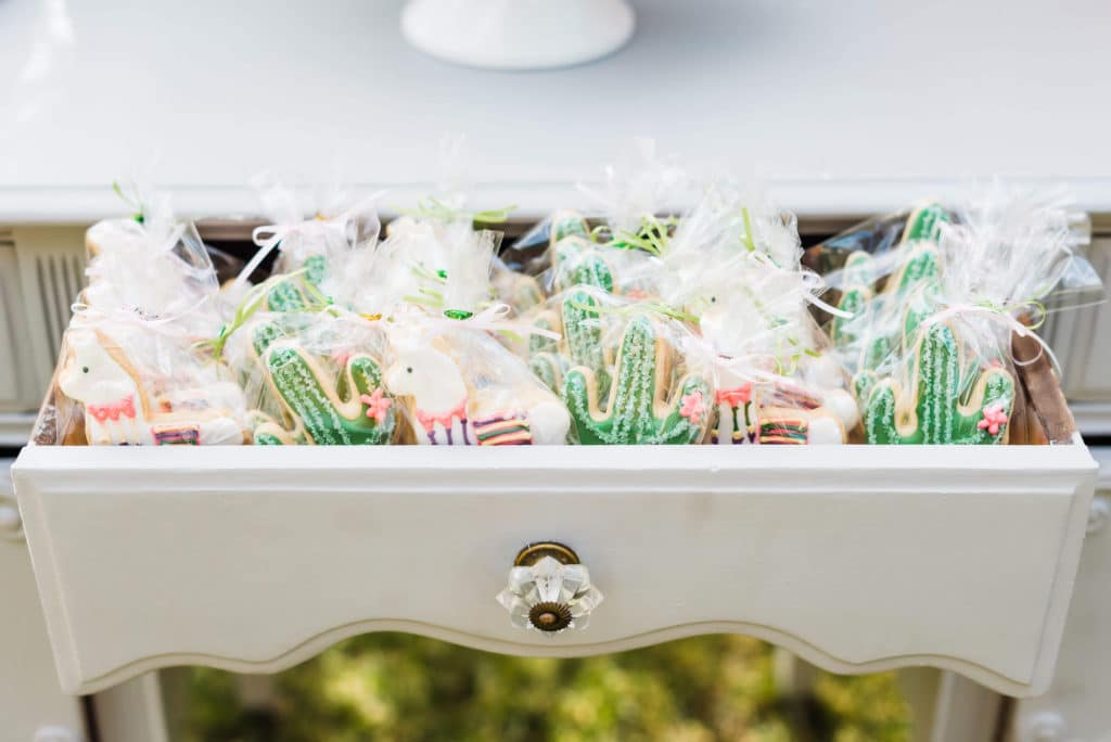 llama and cactus cookies individually wrapped and displayed in a dresser drawer
