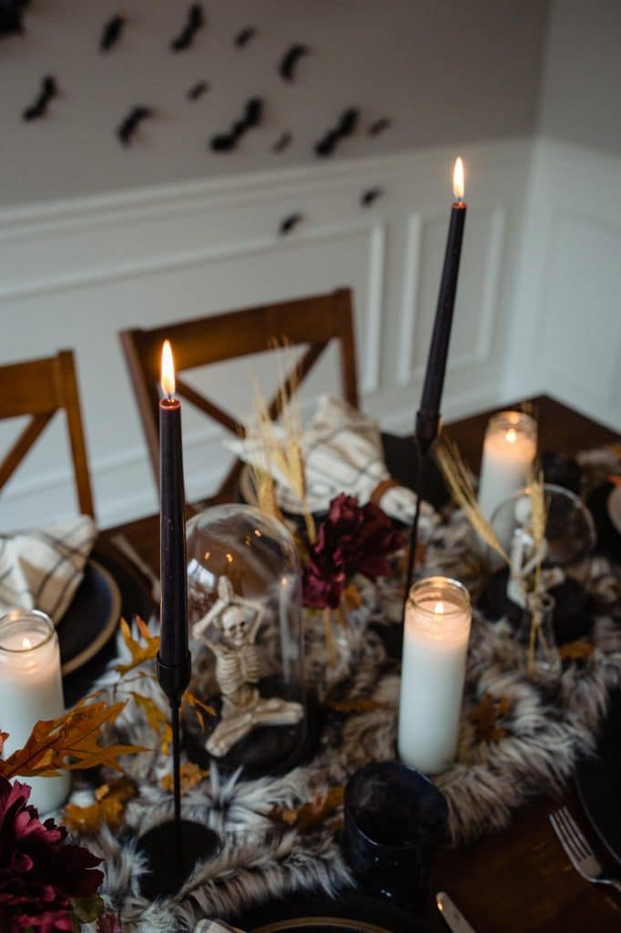 Halloween table with black candles and faux fur