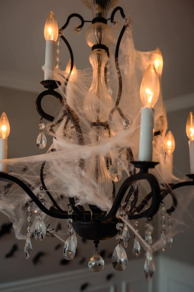 Cobwebs on black chandelier for halloween