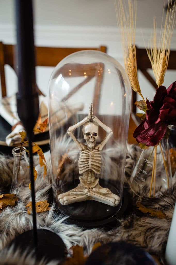 Skeleton in bell jar for halloween table decoration