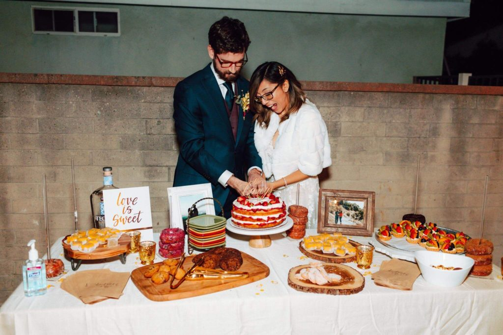 Bride and groom cutting cake at wedding