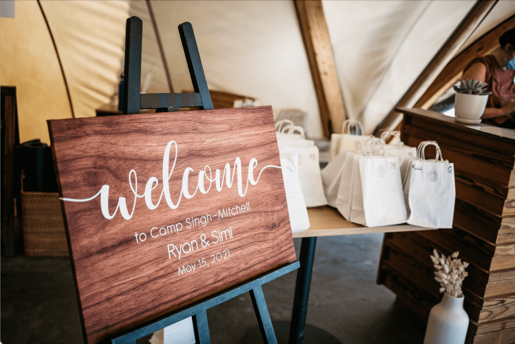Wooden welcome sign for Under Canvas Zion wedding in Utah