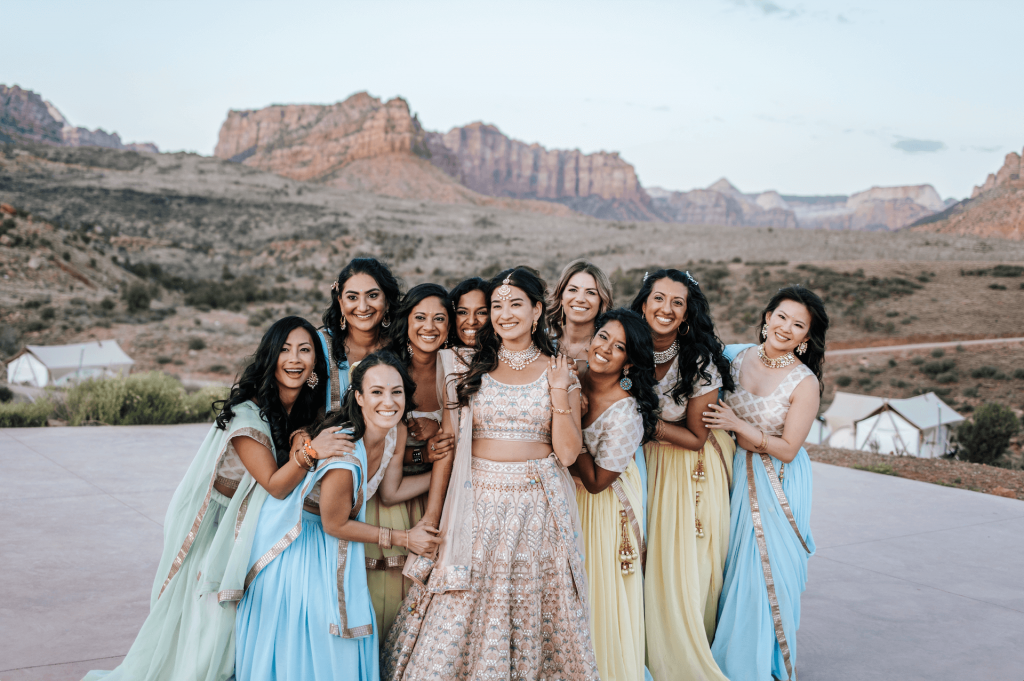 Bride and bridesmaids wearing traditional colorful Indian wedding attire