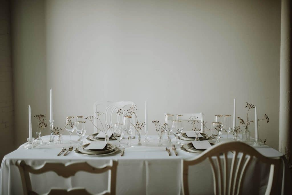 Minimal Halloween wedding table decor with white and gold details