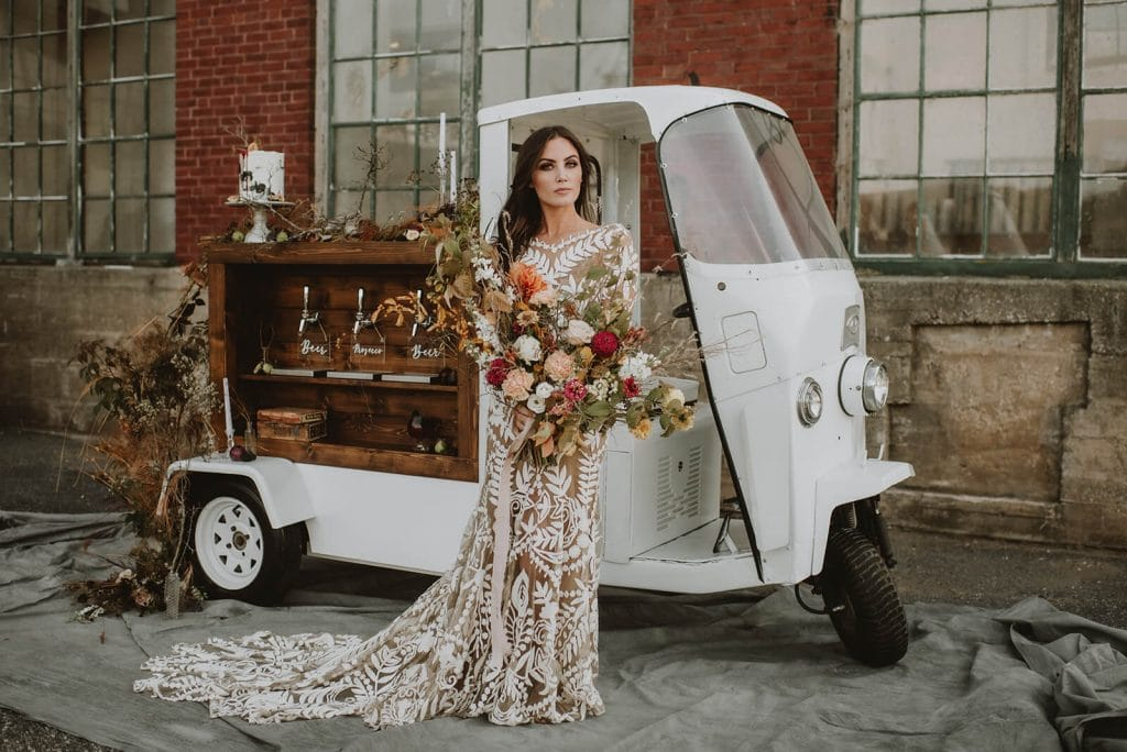 Boho bride with fall bouquet for Halloween wedding